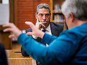 """08 APRIL 2019 - DES MOINES, IOWA: Rep. TIM RYAN listens to teachers in the library at Callanan Middle School. Ryan, a candidate for the Democratic ticket of the US presidency, visited Callanan Middle School in Des Moines to discuss education issues. Ryan declared his candidacy on the US television show """"The View"""" on April 4. Ryan, 45 years old, represents Ohio's 13th District, which includes Lordstown, where a large General Motors plant recently closed. He is the latest Democrat to announce his candidacy to be the Democratic nominee in the 2020 election. Iowa holds its presidential caucuses on Feb. 3, 2020.       PHOTO BY JACK KURTZ"""