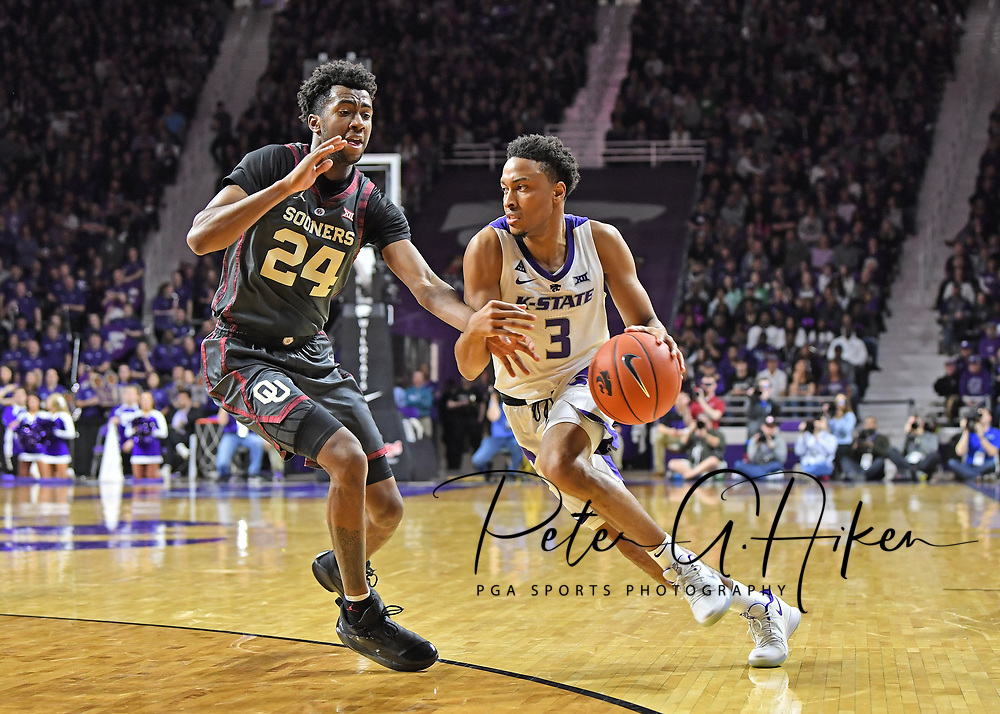MANHATTAN, KS - MARCH 09:  Kamau Stokes #3 of the Kansas State Wildcats drives to the basket against Jamal Bieniemy #24 of the Oklahoma Sooners during the second half on March 9, 2019 at Bramlage Coliseum in Manhattan, Kansas.  (Photo by Peter G. Aiken/Getty Images) *** Local Caption ***  Kamau Stokes; Jamal Bieniemy