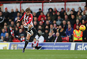 Brentford midfielder John Swift shoots during the Sky Bet Championship match between Brentford and Brighton and Hove Albion at Griffin Park, London, England on 26 December 2015.