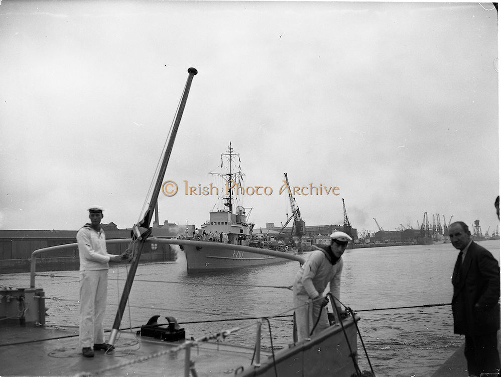 """27/07/1962<br /> 07/27/1962<br /> 27 July 1962<br /> German Naval ships visit Dublin. Three German Naval Minelayers the """"Hummel"""", """"Bremse"""" and """"Biene"""" arrived in Dublin on a five day visit. Image shows the """"Biene"""" F207 getting ready to dock and """"Bremse"""" F208  in the foreground at the South Wall, Dublin."""