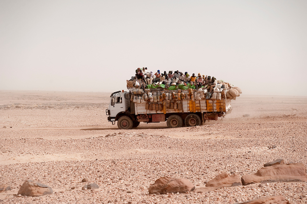 Truck full of migrants going to Dirkou, at the libyan border, through the Ténéré desert. A long and dangerous trip fot all young African migrants.