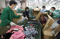 HONG  KONG, CHINA -  MARCH 22 :  Workers at the Fook Woo confidential materials destruction company destroy counterfeit items seized by the Hong Kong customs agents in Hong Kong, China on Thursday, March 22, 2007.  Among the many items that were destroyed were handbags, shoes and watches copied from many popular manufacturers such as Nike, Rolex, Gucci, Omega and Channel.  (Photo by David Paul Morris )
