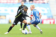 Brighton & Hove Albion winger Anthony Knockaert (11) and Wigan Athletic midfielder David Perkins (4) during the EFL Sky Bet Championship match between Wigan Athletic and Brighton and Hove Albion at the DW Stadium, Wigan, England on 22 October 2016.