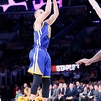 11 April 2014: Golden State Warriors guard Stephen Curry (30) takes a jumpshot during the Golden State Warriors 112-95 victory over the Los Angeles Lakers at the Staples Center, Los Angeles, California, USA.