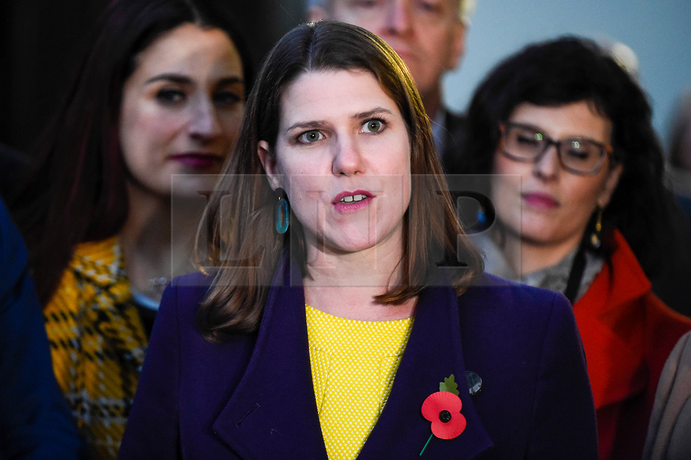 © Licensed to London News Pictures. 30/10/2019. LONDON, UK.  Jo Swinson, Leader of the Liberal Democrats, (C) addresses the media outside the Houses of Parliament.  She stood with senior members of her party, as the Lib Dems launched their election campaign ahead of the General Election on 12 December.  Photo credit: Stephen Chung/LNP