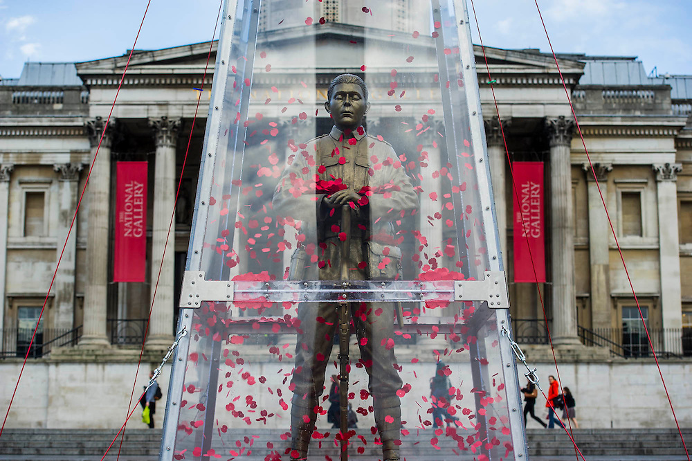 The Every Man Remembered sculpture in Trafalgar Square unveiled by Royal British Legion beneficiary Serena Alexander - Serena lost her son, Sam Alexander MC, in Afghanistan and received help through the Legion's Independent Inquest Advice Service. Her links to the First World War are extensive and she is helping to promote the Every Man Remembered website. Her own Great Uncle, Norman Birtwistle MC was awarded the Military Cross before being killed in action during one of the last cavalry charges in 1918. The sculpture is a collaborative piece with the artist Mark Humphrey - being 7.5-metre high it will sit in Trafalgar Square until 16 November. Made of brass, it is loosely based on the Unknown Solider and stands on a plinth of limestone sourced from the Somme. It is encased in a Perspex obelisk, surrounded by poppies which float up around the figure every five minutes.  The sculpture will carry out a four-year tour of Great Britain, visiting a number of different locations across the country where members of the public will be invited to remember all those who fell during the First World War.