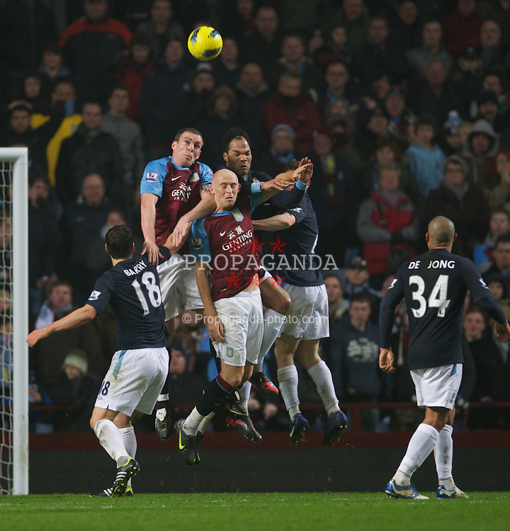 BIRMINGHAM, ENGLAND - Sunday, February 12, 2012: Manchester City's Joleon Lescott challenges Aston Villa's Richard Dunne and James Collins during the Premiership match at Villa Park. (Pic by David Rawcliffe/Propaganda)