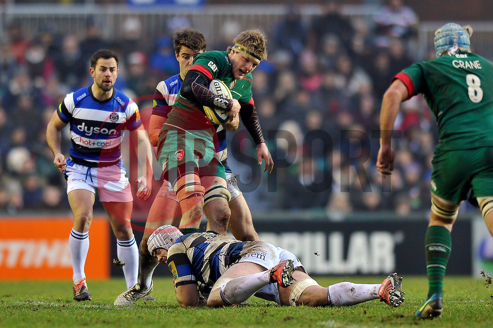 Jamie Gibson of Leicester Tigers is tackled - Photo mandatory by-line: Patrick Khachfe/JMP - Mobile: 07966 386802 04/01/2015 - SPORT - RUGBY UNION - Leicester - Welford Road - Leicester Tigers v Bath Rugby - Aviva Premiership
