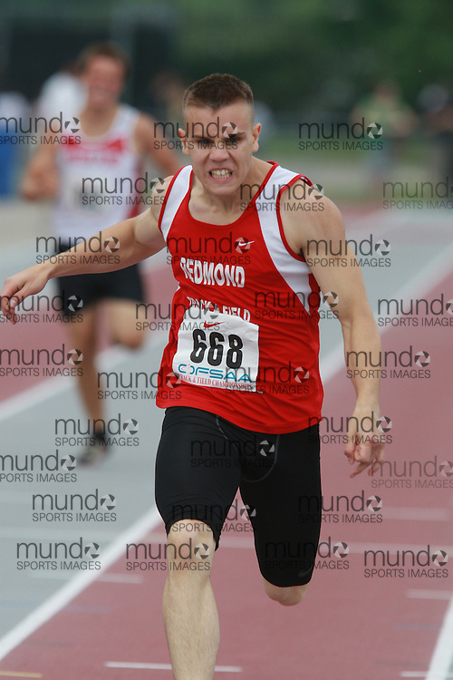 (London, Ontario}---03 June 2010) Dylan Dimock of Father Redmond - Toronto competing in the 400 meters at the 2010 OFSAA Ontario High School Track and Field Championships. Photograph copyright Dave Chidley / Mundo Sport Images, 2010.