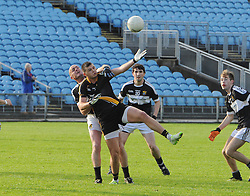 Louisburgh&rsquo;s Padraig Prendergast tries to gather posession ahead of Kilmeena&rsquo;s Liam Heanue during the junior semi final.<br /> Pic Conor McKeown