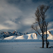 Snow blankets Grand Teton and Jackson Hole valley during winter in Grand Teton National Park, Wyoming.