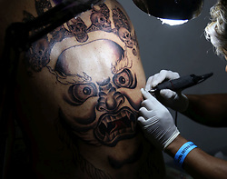 April 27, 2019 - Kathmandu, Nepal - A tattoo lover gets his tattoo art at 9th International Tattoo Convention. More than 150 National and International Tattoo artists participated in three days convention. (Credit Image: © Archana Shrestha/Pacific Press via ZUMA Wire)