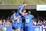 Callum Kennedy defender for AFC Wimbledon (3) jumps highest after Toyosi Olusanya striker AFC Wimbledon (35) makes it 1-0 during the Sky Bet League 2 match between AFC Wimbledon and Newport County at the Cherry Red Records Stadium, Kingston, England on 7 May 2016. Photo by Stuart Butcher.