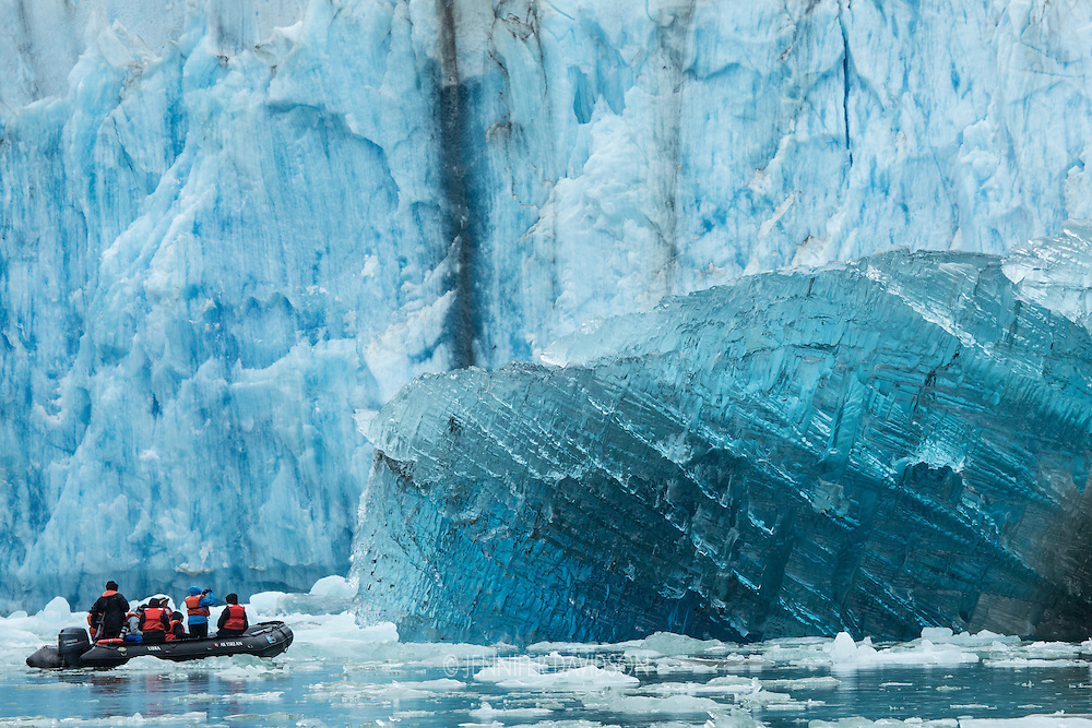 Guests from the National Geographic Sea Lion ride in small inflatable boats in front of Dawes Glacier in Endicott Arm, part of the Tracy Arm - Fords Terror Wilderness, Alaska.