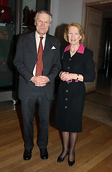 SIR ANTHONY & LADY FIGGIS he is Her Majesty's Marshal of Diplomatic Corps at an exhibition of art entitled 'Royal Academicians in China: 2003-2005' held at the Royal Academy of Arts, Burlington House, Piccadilly, London on 11th January 2005.<br />