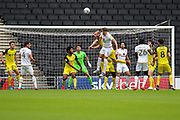 Burton Albion forward Liam Boyce and Milton Keynes Dons defender Regan Poole challenge for the ball in the air during the EFL Sky Bet League 1 match between Milton Keynes Dons and Burton Albion at stadium:mk, Milton Keynes, England on 5 October 2019.