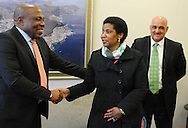 CAPE TOWN, SOUTH AFRICA - Friday 22 August 2014, Dr Phumzile Mlambo-Ngcuka, Under-Secretary-General and Executive Director of UN (United Nations) Women from New York and former South African Deputy President, greets new national soccer coach, Ephraim &quot;Shakes&quot; Mashaba (left) with assistant coach, Oweb=n Da Gama (right) in an impromptu meeting during the announcement that the City of Cape Town will join the United Nations Women Safe Cities Global Initiative designed to assist local authorities in making cities safer for women and girls. Cape Town is the first city in southern Africa to join the UN Women Safe Cities Global Initiative, and looks forward to learning from and sharing its experiences with other international cities and African counterparts in Kigali and Nairobi.<br /> Photo by Roger Sedres/ImageSA