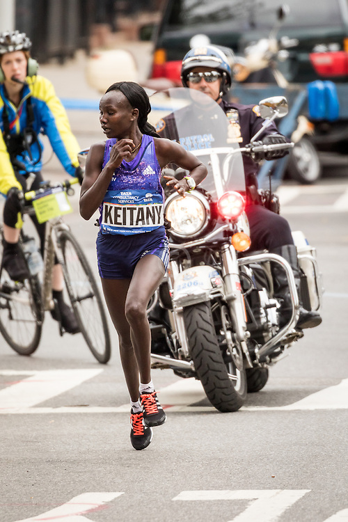 Mary Keitany, Kenya, leads the break at mile 21 in Bronx on way to victory