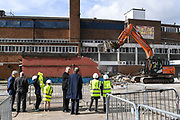 Council Leader Stephen Alambritis AFC Wimbledon legend Ian Cooke, AFC Wimbledon legend Dave Bassett, Chief Executive Erik Samuelson and children from both Smallwood Primary School and children from AFC Wimbledon player development programme during the AFC Wimbledon Demolition Event, marking the start of building works at the AFC Wimbledon Stadium Site, Plough Lane, United Kingdom on 16 March 2018. Picture by Stephen Wright.