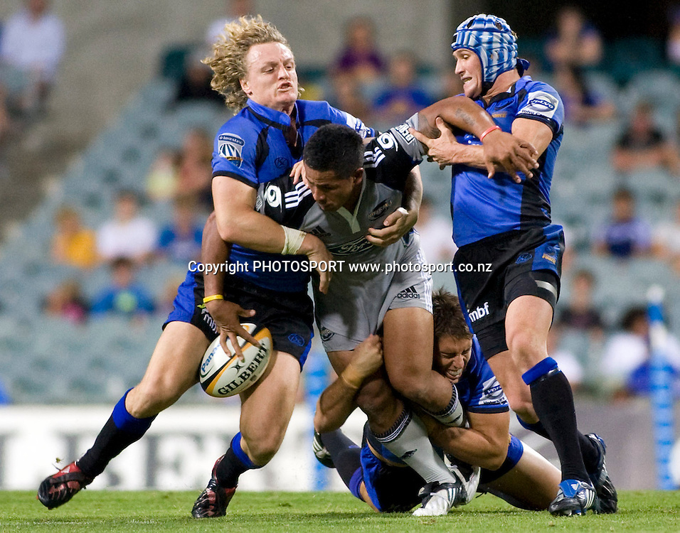 David Smith is tackled by Ryan Cross (L), Matt Giteau (R) and Luke Holmes during the Super 14 rugby union match, Round 9, Western Force v Hurricanes, Subiaco Oval, Perth, Australia, Friday 10 April 2009. Score was Hurricanes 28 - Force 27 in front of 20,737 fans. Photo: Christian Sprogoe/PHOTOSPORT