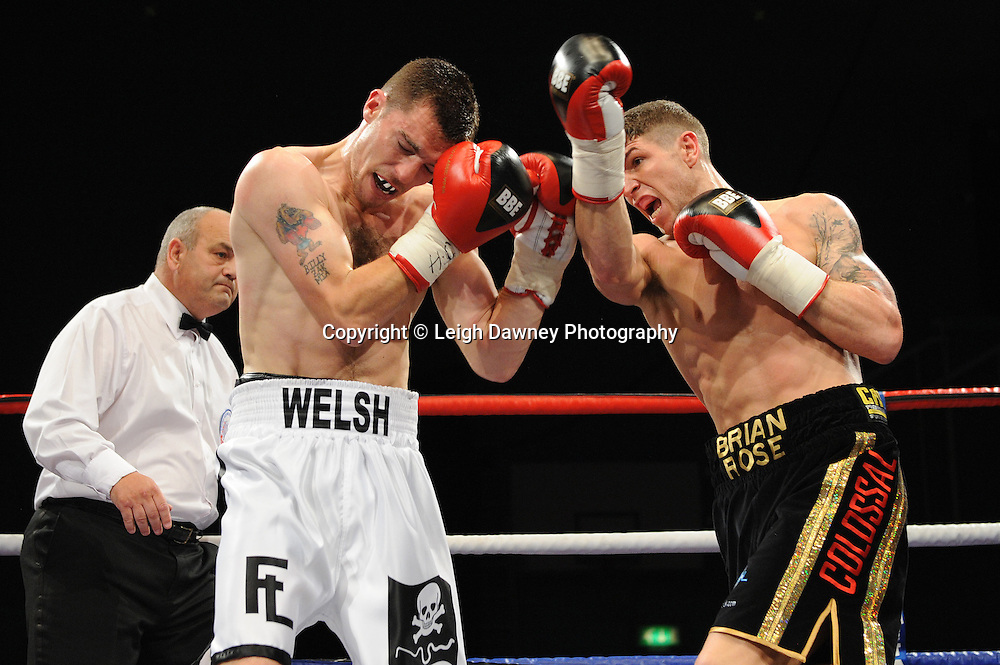 Brian Rose (black shorts) defeats Martin Welsh for the English Light Middleweight title at Medway Park, Gillingham, Kent, UK on 13th May 2011. Frank Maloney Promotions. Photo credit © Leigh Dawney 2011.