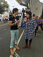 ROBBIE ROSEN, an American Idol Season 10 Semi-finalist in 2011, talks with a fan at the Merrick Chamber of Commerce Fall Festival on Long Island. Rosen is a Merrick resident.