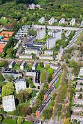 Nederland, Zuid-Holland, Den Haag, 09-05-2013; Mariahoeve, nieuwbouwwijk uit de jaren zestig ('60) van de vorige eeuw.  Nadrukkelijke  wegenstructuur met hoofdverkeerswegen en ontsluitingswegen, verdeelt de wijk in buurten met verschillende woningtypes en overvloedige openbaar groen. Wederopbouwgebied. Boben on beeld Haagse Bos en paleis Huis ten Bosch. <br /> New residential area built in the sixties,  The structure of the roads divides the district into neighborhoods with different housing types and many public green areas.<br /> Reconstruction area. Royal Palace Huis ten Bosch top pic.<br /> luchtfoto (toeslag op standard tarieven)<br /> aerial photo (additional fee required)<br /> copyright foto/photo Siebe Swart