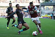 Liverpool defender Trent Alexander-Arnold (66) gets the tackle on Burnley midfielder Dwight McNeil (11) during the Premier League match between Burnley and Liverpool at Turf Moor, Burnley, England on 31 August 2019.