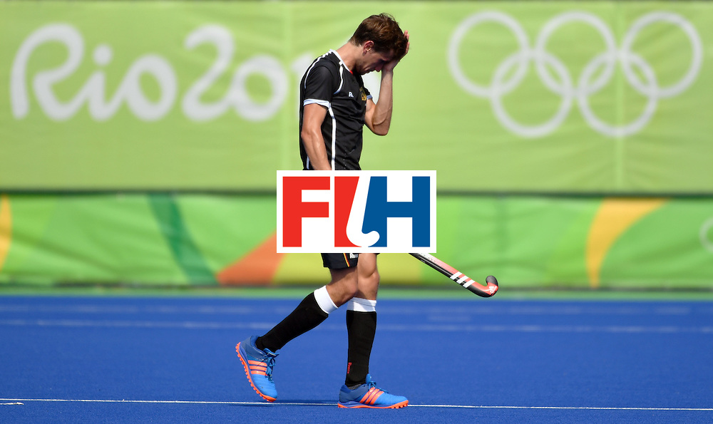 Germany's Florian Fuchs leaves the pitch after the men's semifinal field hockey Argentina vs Germany match of the Rio 2016 Olympics Games at the Olympic Hockey Centre in Rio de Janeiro on August 16, 2016. / AFP / Pascal GUYOT        (Photo credit should read PASCAL GUYOT/AFP/Getty Images)