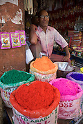 Man selling coloured paint powder during Holi festival in Jaipur, Rajasthan, India.