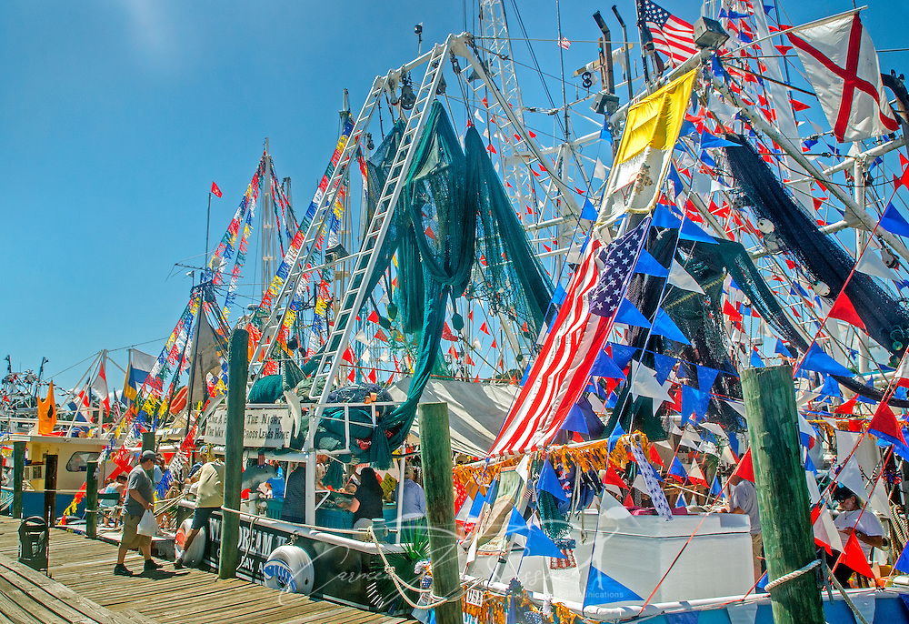 Decorated shrimp boats line up for the 66th annual Blessing of the Fleet in Bayou La Batre, Alabama, May 3, 2015. The first fleet blessing was held by St. Margaret's Catholic Church in 1949, carrying on a long European tradition of asking God's favor for a bountiful seafood harvest and protection from the perils of the sea. The highlight of the event is a blessing of the boats by the local Catholic archbishop and the tossing of a ceremonial wreath in memory of those who have lost their lives at sea. The event also includes a land parade and a parade of decorated boats that slowly cruise through the bayou. (Photo by Carmen K. Sisson/Cloudybright)