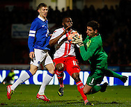 Picture by David Horn/Focus Images Ltd +44 7545 970036<br /> 25/01/2014<br /> Francois Zoko of Stevenage (centre) goes close early on but is stopped by Joel Robles of Everton during the The FA Cup match at the Lamex Stadium, Stevenage.