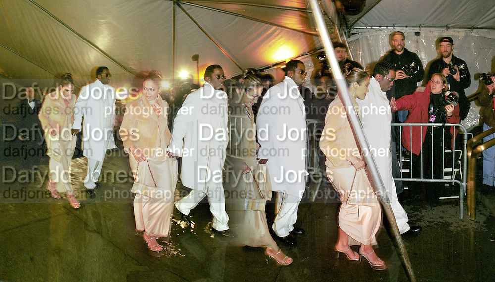 Jennifer Lopez arriving with Sean Puffy Combs at the Costume Institute Benefit. Metropolitan Museum.  New York. 6 December 1999.  © Copyright Photograph by Dafydd Jones 66 Stockwell Park Rd. London SW9 0DA Tel 0171 733 0108 www.dafjones.com