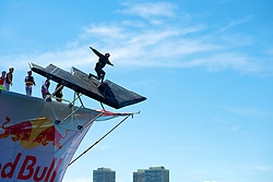 """Red Bull Flugtag, Camden Waterfront, NJ USA - September 15, 2012;.33 teams compete in the second edition of the Philly Red Bull Flug Tag. Thousands came out on both sides of the river to see handmade crafts attempt to fly. Team """"New Kids on the Dock"""" from Philadelphia, PA took the 1st prize for covered distance...Pilot of Team Stealth Bomber Zombie Killers dives down the 30ft ramp into the Delaware. .."""
