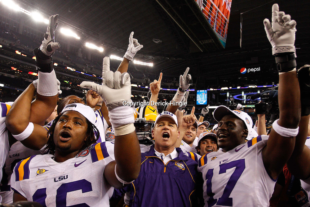 Jan 7, 2011; Arlington, TX, USA; LSU Tigers head coach Les Miles celebrates with his players following a win over the Texas A&M Aggies in the 2011 Cotton Bowl at Cowboys Stadium. LSU defeated Texas A&M 41-24.  Mandatory Credit: Derick E. Hingle
