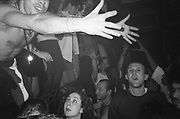 Raver holding out his hands, Dream FM Pirate Radio Benefit, Labyrinth Dalston, London, 1994.