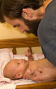 A new father and his three week old infant son communicate with their eyes.