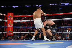 NEW YORK, NY - JULY 26: Gennady Golovkin (white trunks) knocks down Daniel Geale (silver/black trunks) during their WBA/IBO Middleweight World Championship bout at Madison Square Garden on July 26, 2014 in New York, New York. (Photo by Ed Mulholland/K2 Promotions)