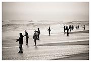 While you were sleeping.  Fishermen at dawn at Robert Moses Beach, Long Island