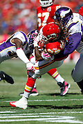 Kansas City Chiefs running back Dexter McCluster (22) gets gang tackled as he runs for a gain of five yards in the second quarter during the NFL week 4 football game against the Minnesota Vikings on Sunday, October 2, 2011 in Kansas City, Missouri. The Chiefs won the game 22-17. ©Paul Anthony Spinelli
