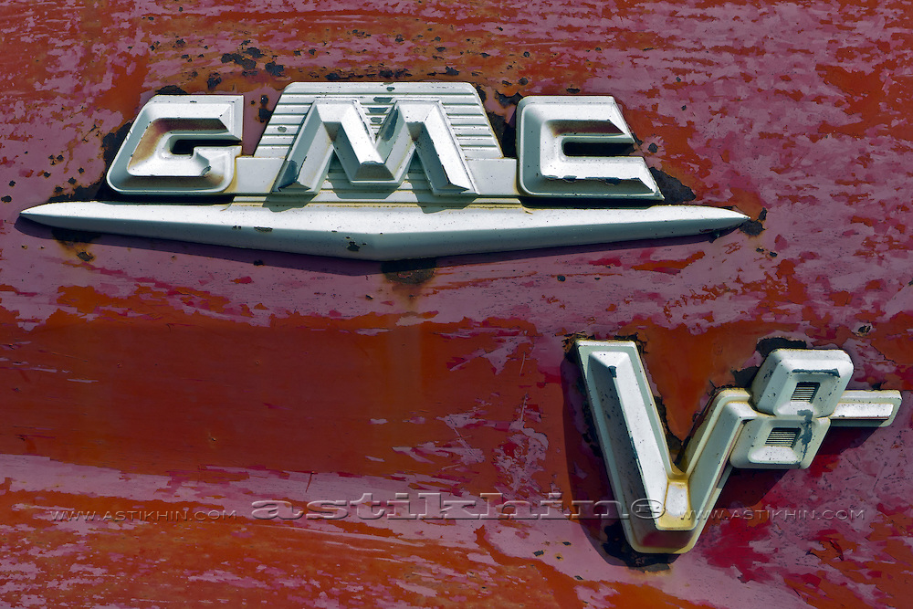 Sign of GMC V-8 Series 350 2 ton flatbed truck.