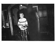 Lady Henrietta Bathurst arriving in bad weather with a ( borrowed? ) sweater over her ball dress at a country house party. 1981 approx. © Copyright Photograph by Dafydd Jones 66 Stockwell Park Rd. London SW9 0DA Tel 020 7733 0108 www.dafjones.com