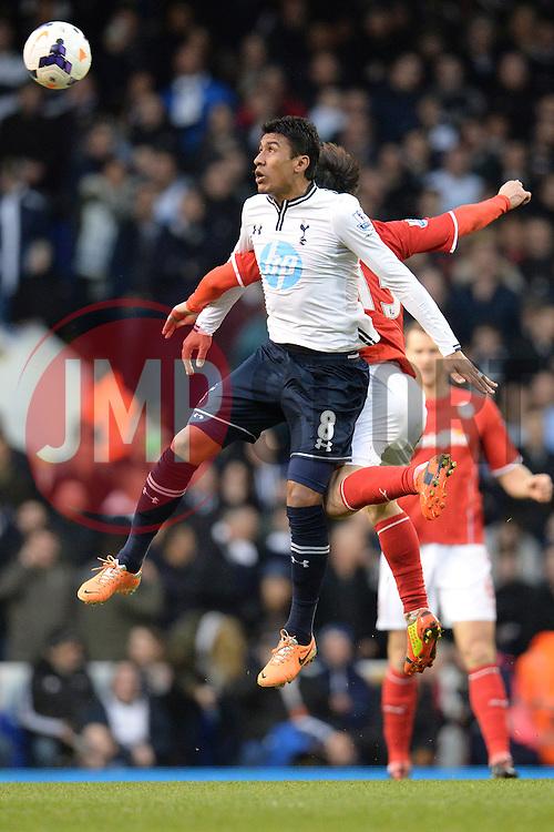 Tottenham's Paulinho and Cardiff's Kim Bo-Kyung  - Photo mandatory by-line: Mitchell Gunn/JMP - Tel: Mobile: 07966 386802 02/03/2014 - SPORT - FOOTBALL - White Hart Lane - London - Tottenham Hotspur v Cardiff City - Premier League