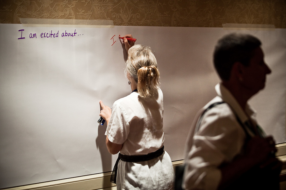 Donna Morgan, of the Brushy Fork Institute, starts an idea board for the second day of the National Rural Assembly Gathering on Wednesday, June 29, 2011.