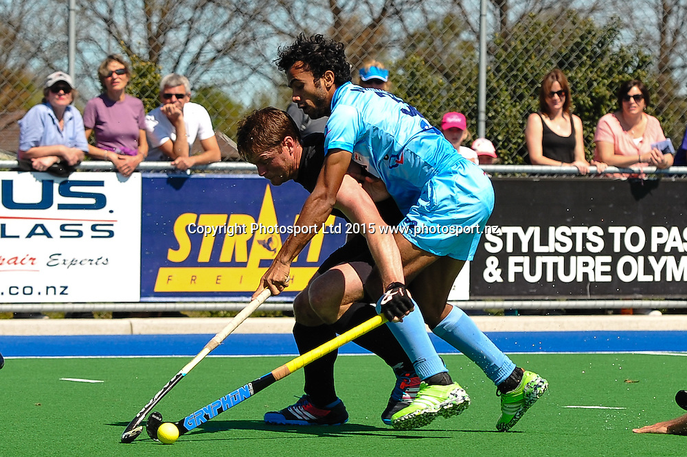 Brad SHAW of the Black Sticks is tackled by Chandanda Aiyanna Nikkin Thimmaiah of India during the Mens Hockey International, 2015 South Island Tour game between the New Zealand Black Sticks V India, at Marist Park, Christchurch, on the 11th October 2015. Copyright Photo: John Davidson / www.photosport.nz