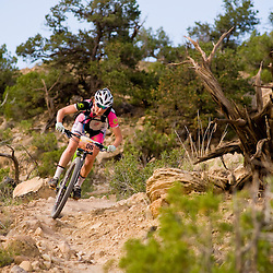 Jennifer Smith pins a corner on the Butterknife Trail during the Grand Junction Off-Road. Smith placed third for the day. <br /> Photos by Brian Leddy