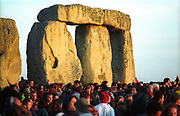 Heads of summer solstice revellers infront of Stone Henge, UK 2005