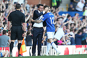 Everton defender Lucas Digne (12) celebrates with Everton Manager Marco Silva after scoring 3-0 during the Premier League match between Everton and Manchester United at Goodison Park, Liverpool, England on 21 April 2019.