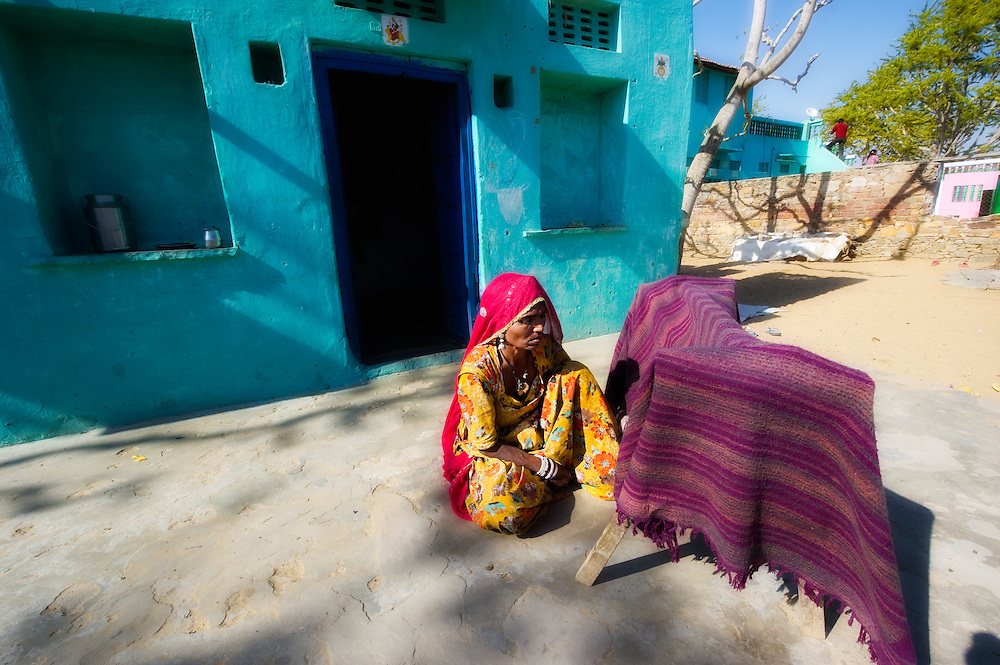Rajasthani grandmother makes sure her grandson is in the shade, by covering a cradle with a shawl.
