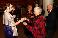 Alicia Frandsen of Kettering (left) hands out champagne to VIP ticket holders before the 10th Anniversary Concert at the Schuster Center in downtown Dayton, Friday, March 1, 2013.